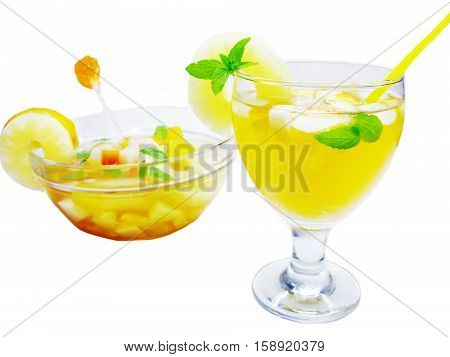 fruit cruchon cocktail punch in bowl and glass with ice and fruit