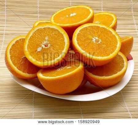 sliced ripe juicy oranges closeup. horizontal photo.