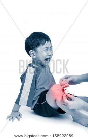 Asian Boy With Wound His Leg Crying. Nurse Provides First Aid At Knee With Red Spot Sore Area
