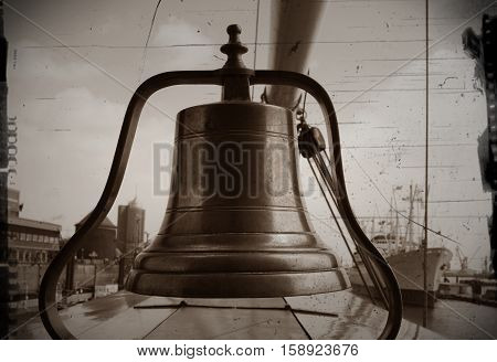 Old ship's bell on a sailing ship