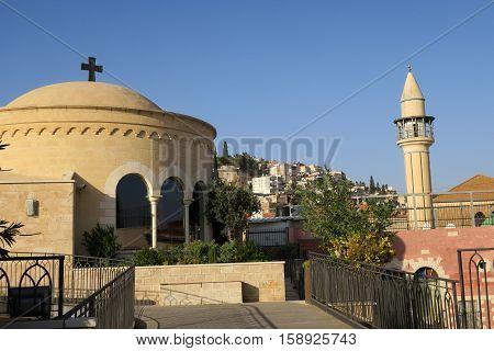 Church next to a minaret in Nazareth