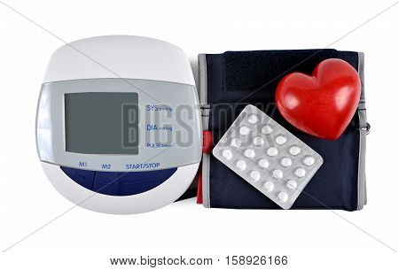 Digital blood pressure monitor with heart and pills isolated on white background