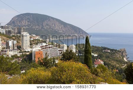 Gurzuf, Crimea - September 7, 2016: Rocky Beach with a protruding rock domes of churches and residential buildings located among different vegetation. The settlement Gurzuf and Bear Mountain Au-Dag . Crimea. View from Bolgatura Mountains in Gurzuf. Locate