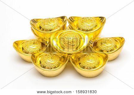 Stack of Chinese Gold Ingots on white Background.