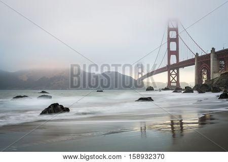 Golden Gate bridge during a misty golden hour