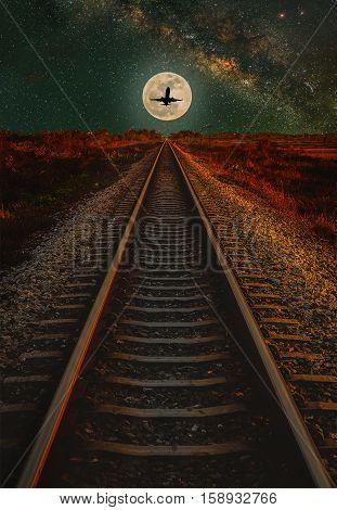 Railway Track with the moon and milky way in night sky. (Elements of this moon image furnished by NASA)
