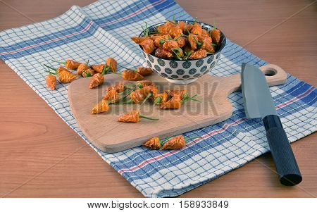 Lot Of Small Dried Chilli Peppers In The Kitchen On Dish Towel Photography