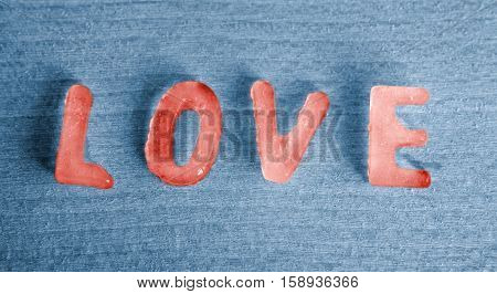 the word Love as red icecubes on blue background