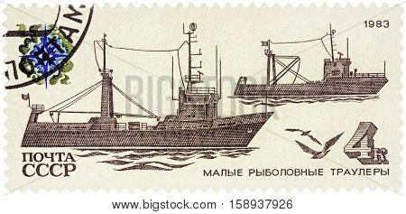 MOSCOW RUSSIA - NOVEMBER 25 2016: A stamp printed in USSR (Russia) shows coastal trawlers series