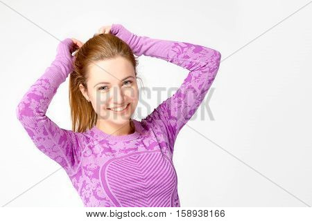 Young Girl Adjusts Her Hair In A Ponytail