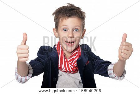 Happy little boy shows thumbs up isolated on white background