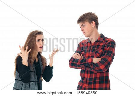 crazy young stylish couple in love having fun in studio isolated on white background