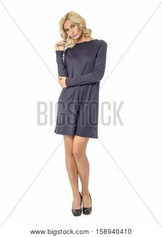 Portrait Of Flirtatious Woman In Short Blue Dress Isolated On White