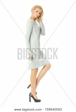Portrait Of Flirtatious Woman In Sweater Dress Isolated On White