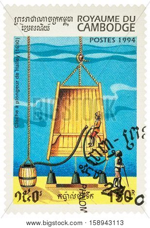 MOSCOW RUSSIA - NOVEMBER 28 2016: A stamp printed in Cambodia shows old diving bell of Edmond Halley (1690) series