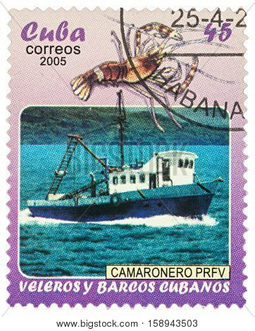 MOSCOW RUSSIA - NOVEMBER 29 2016: A stamp printed in Cuba shows fishing ship and shrimp series