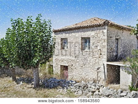 traditional stone house at Kalamata Peloponnese Greece - snow winter day