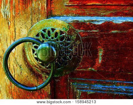 Detail of a vintage wooden door's metal casings.