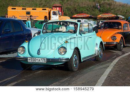 SAINT PETERSBURG, RUSSIA - SEPTEMBER 04, 2016 Blue Volkswagen Beetle 1300 Convertible - the participant of parade of vintage transport in Kronstadt