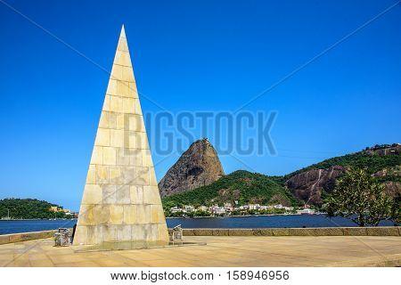 20 November, 2016. Pyramid Estacio de Sa in Park Flamengo Aterro on the background of Sugarloaf mountain Rio de Janeiro Brazil