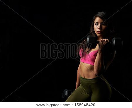 Sexy Latina Girl Holding Dumbbell