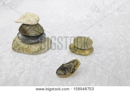 A view of a group of pebbles on a snowy background