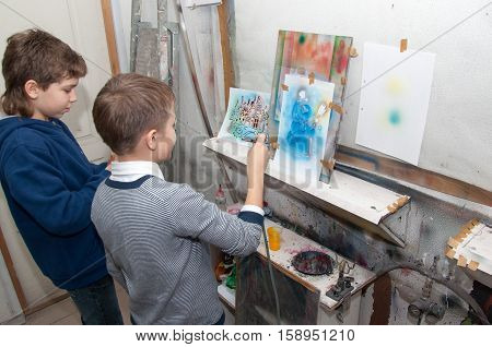 Boys Teenager Paint With An Airbrush Brightly Colored Pictures In A Artistical Studio - Russia, Mosc