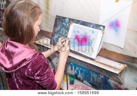 Girl Teenager Paints With An Airbrush Brightly Colored Christmas Winter Pictures In A Artistical Stu