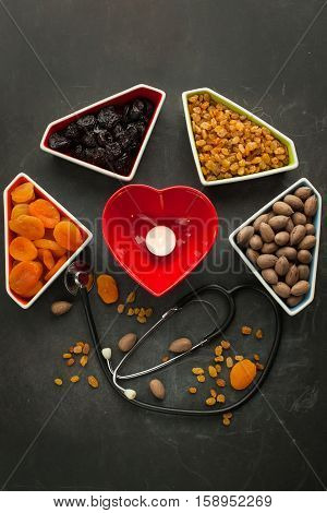 Dried fruits an nuts for healthy heart, full of vitamins and potassium, antioxidant. Organic food for everyone's health.