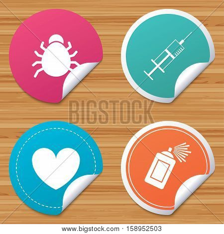 Round stickers or website banners. Bug and vaccine syringe injection icons. Heart and spray can sign symbols. Circle badges with bended corner. Vector