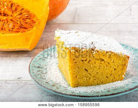 pumpkin pie, pumpkin and pumpkin piece  on a white wooden table