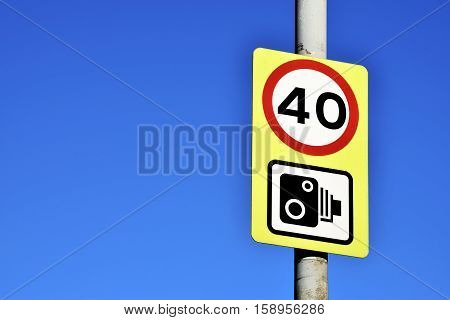 Speed limit sign on the beautiful blue sky