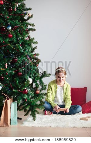 Girl Listening To Christmas Carols