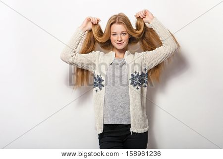 Human Pose Expressions And Emotions. Young Adorable Redhead Woman In Cozy Sweatshirt Showing Holding