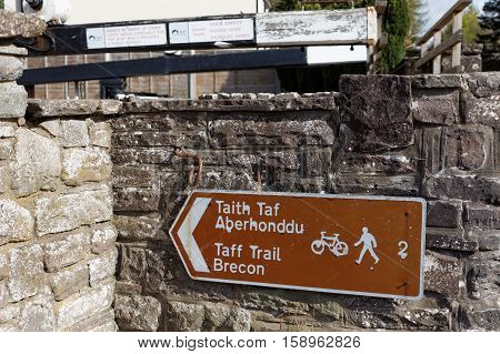 BRECON BEACONS NATIONAL PARK, WALES, 28 APRIL 2016. Editorial photograph of Taff Trail route sign. The Taff Trail runs from Cardiff Bay to Brecon and is popular amongst cyclists and walkers.