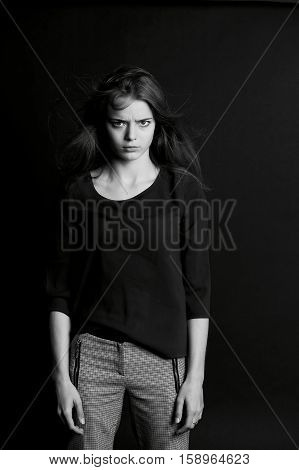 A young girl with long hair. Daring look in . BW