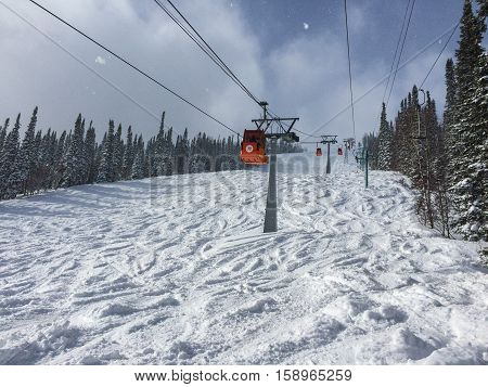 Cable lifts in a ski resort tin the sunny weather.