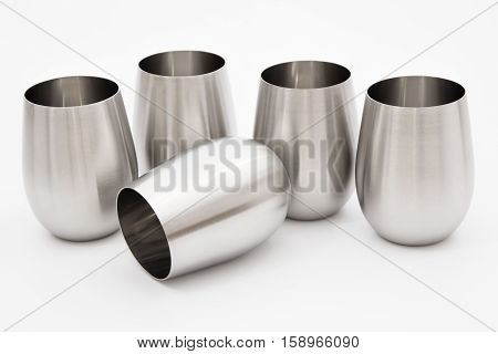 Modern metal stainless steel inox glasses for wine - for camping or for elegant interior alternative - isolated on white