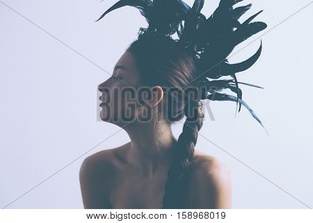 Young Sexy Mixed Race Caucasian Woman Vogue Portrait With Feather Mohawk Accessory Wearing Black Bod