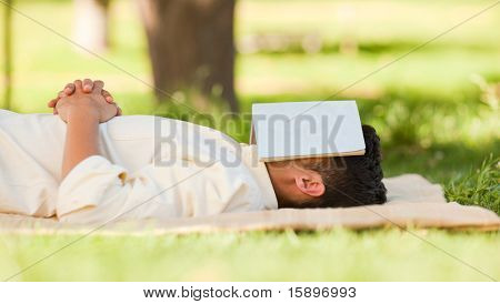 Man sleeping with his book