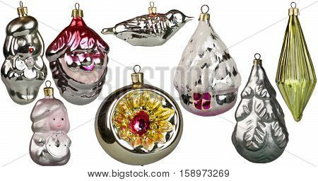 Vintage Christmas toys for Christmas tree decorations of the last century on a white background, montage, isolated