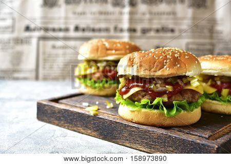 Cheeseburger With Meat Cutlet And Pickled Vegetable.