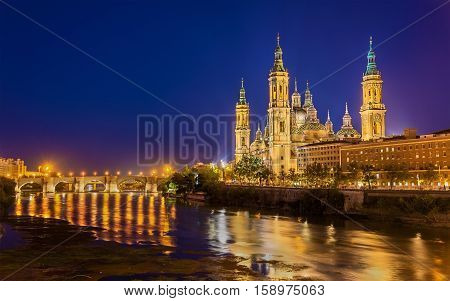 Basilica of Our Lady of the Pillar and the Ebro River - Zaragoza, Spain poster