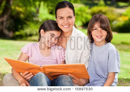 Family looking at their album photo