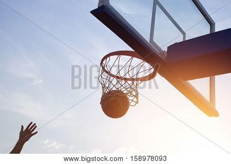 Basketball Going Through The Basket