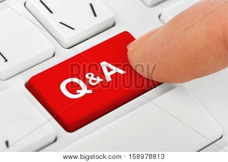 Computer notebook keyboard with Questions and Answers key - technology background - 3D illustration