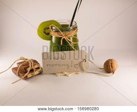 good morning note chocolate and green smoothie on a white background
