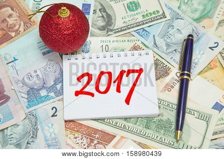 Notebook page with text 2017 background from different world Currencies