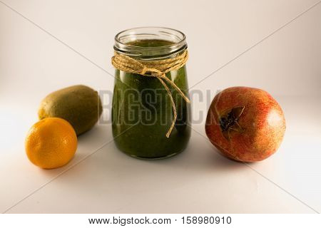 green smoothie from spinach and kiwi on a white background