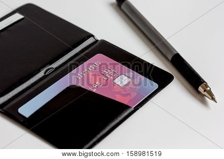Credit cards with card holder close up - online shopping on white background